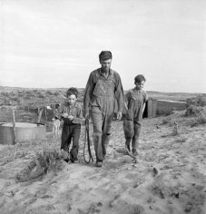 Not originally published in LIFE. Farmer and sons, Oklahoma, 1942. (Alfred Eisenstaedt—Time & Life Pictures/Getty Images)